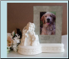 A Porcelain Angel with Dog Urn/Frame